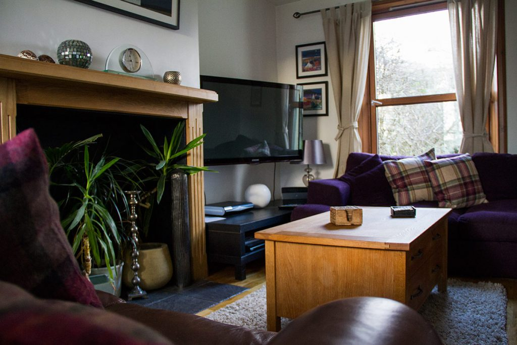 Cosy lounge space, complete with sofas, coffee table and TV